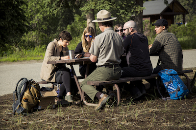Group of researchers at a picnic table.