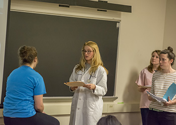 Students in Health Policy and Administration role play