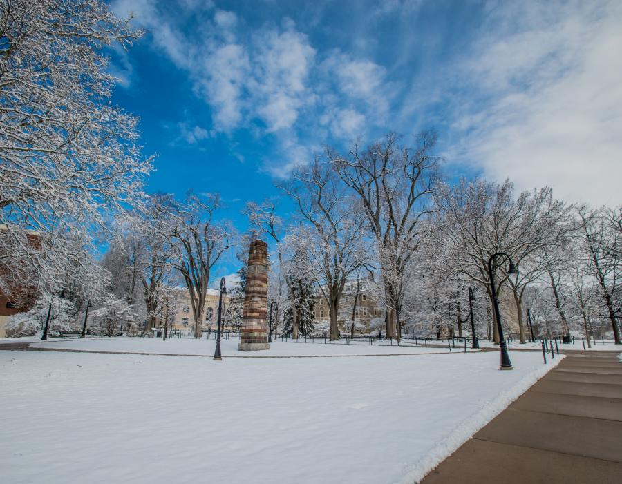 Snowy Penn State campus with blue skies.