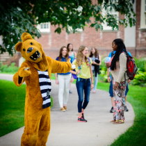 Nittany Lion mascot outside with students.