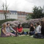 Students sitting outside in a circle