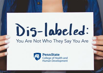 A woman holding a sign. Dis-labeled: You are not who they say you are. Penn State College of Health and Human Development logo