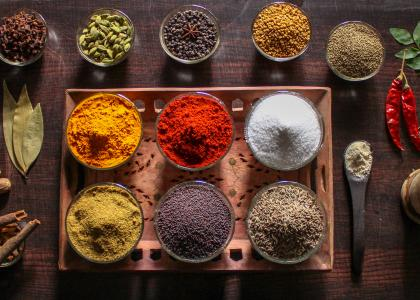 An array of brightly colored spices laid out on a table