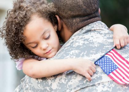 Soldier tells his little girl goodbye