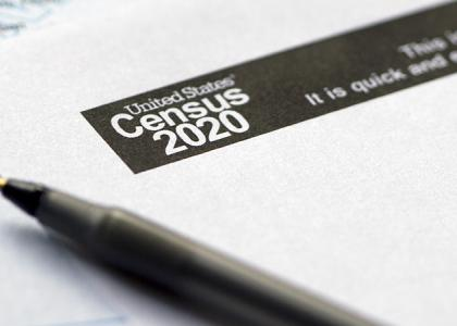 A pen laying on top of a copy of the 2020 Census.