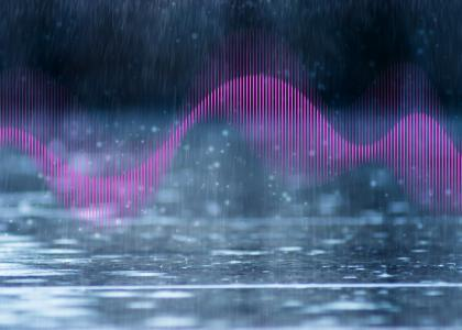 Pink wave in front of rain hitting the ground