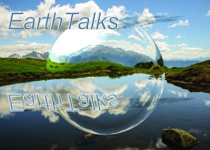 A view of mountains seen from a lake with EarthTalks and a bubble superimposed