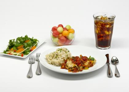 Plate of food and glass