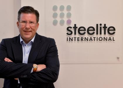 John Miles in front of Steelite sign