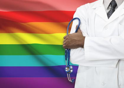 LGBT flag and dr. with stethoscope