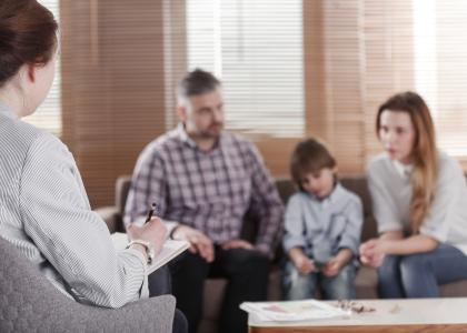 Family speaking with therapist