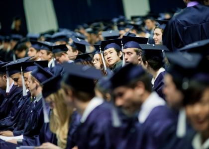crowd of students in graduation caps and gowns