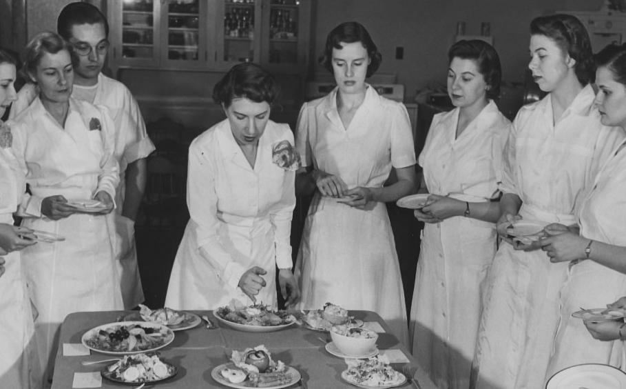 Historical image of a class on food presentation.