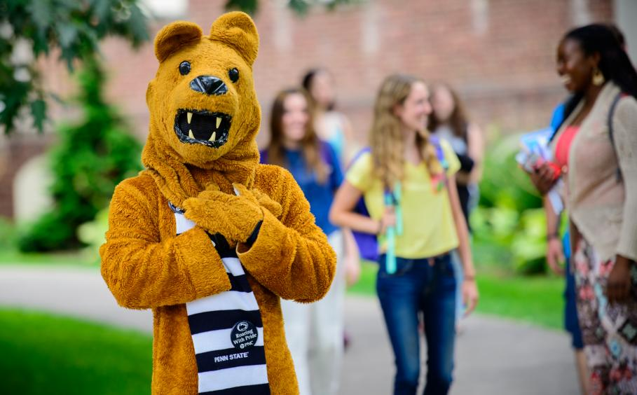 The Lion mascot with students.