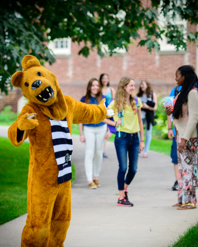 Nittany Lion welcoming you with students in the background