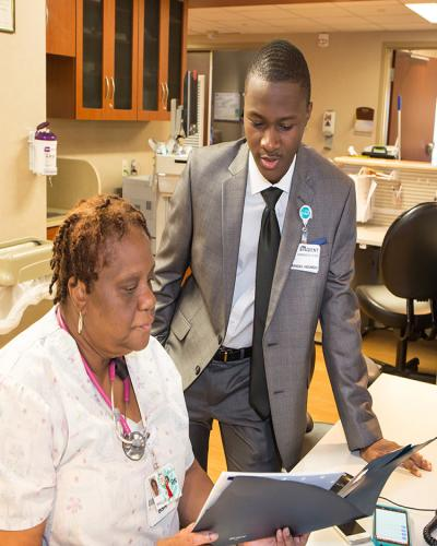 Student working at an internship with a hospital.
