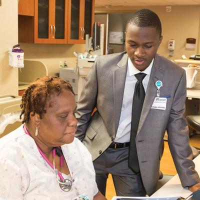 Student intern working with healthcare professional.