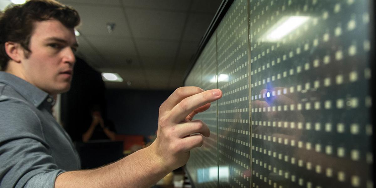 Student using a light wall.