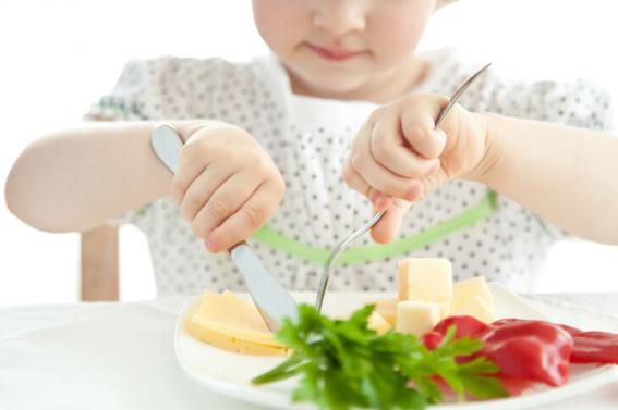 Child eating fruits and vegetables