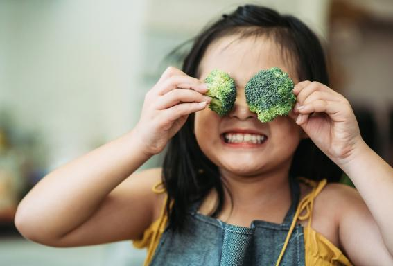 Young child with broccoli